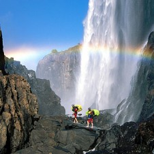 Carrying kayaks across Victoria Falls