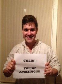 Amazing Race cast member with  Colin sign