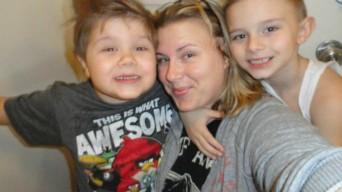 Alicia Hardesty's fiancé, Ashley, with her boys, Joshua and Nicolas