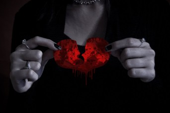 Woman holding broken heart