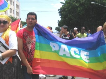 Cuban gay activists holding a rainbow sign