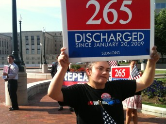 DADT discharge protester with sign