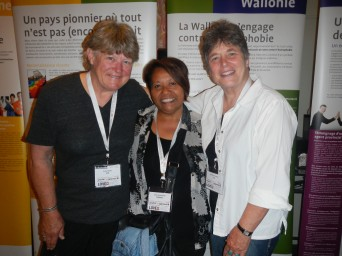 Kathy Wolfe (L) and Barb Verhage (R) of Lesbian.com make their first friend at the Antwerp Human Rights Conference – Anita Kartosemito of Surinam (middle).