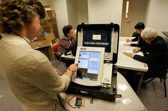 Woman using voting machine