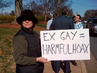 Protester with Ex-gay is a hoax sign