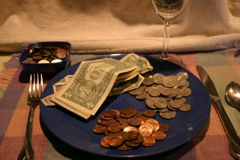 Dinner plate with money on it