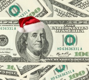 Ben Franklin on $100 bill with Santa hat