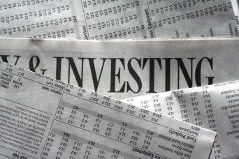Investing headline in newspaper
