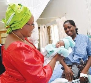 First Lady Dr Christine Kaseba holding a baby