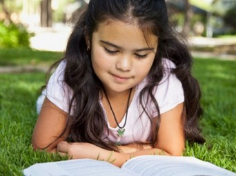 Latina child with book