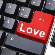 Computer keyboard with love on the enter key