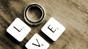Love in Scrabble tiles with rings