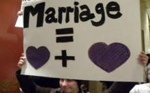 Protestor holds sign supporting marriage equality