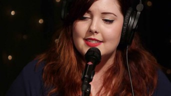 Mary Lambert with headphones