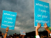 Protestors hold signs supporting same-sex marriage