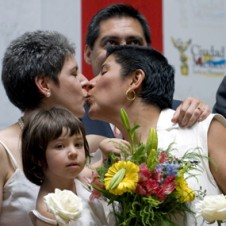 Mexican lesbian couple kissing.