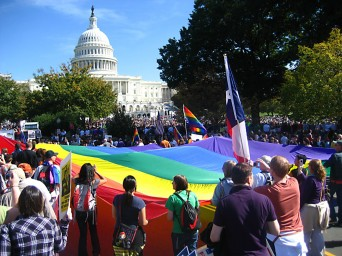 LGBT rally with large rainbow flag in front of US Capitol