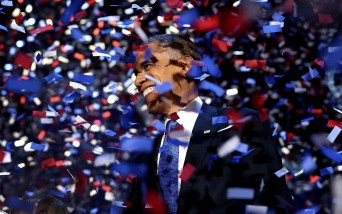 President Barack Obama amidst confetti after giving his victory speech