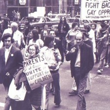 Iconic photo of PFLAG founder Jeanne Manford and her son Morty in 1970s NYC gay rights parade.