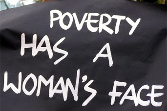 Poverty has a woman's face sign
