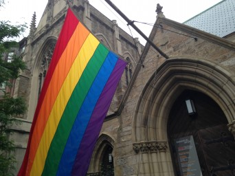 Pride flag in front of church