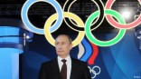 Putin and Olympic rings