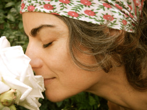 Traci Dinwiddie smelling the flowers in Portland