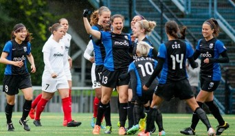 Seattle Reign FC celebrate win over Washington Spirit