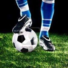 Soccer ball with player foot