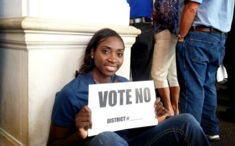 Sophia Young holding Vote No sign