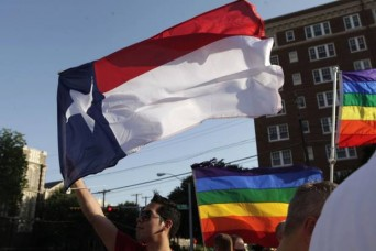 Texas flag and pride flags