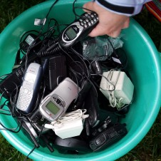 Trash can full of cell phones