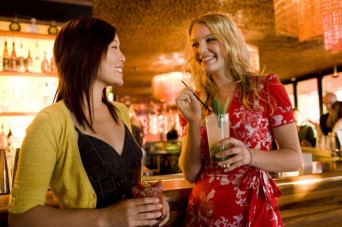 Two young women having cocktails