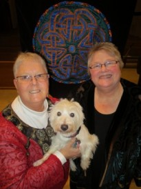 The Rev. Joanne Carlson Brown (left), and the Rev. Christie Lagergren Brown with their dog Thistle