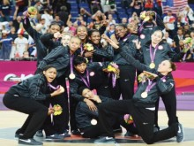 USA basketball women's national team poses with gold medals