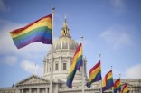Utah state capitol building with pride flags
