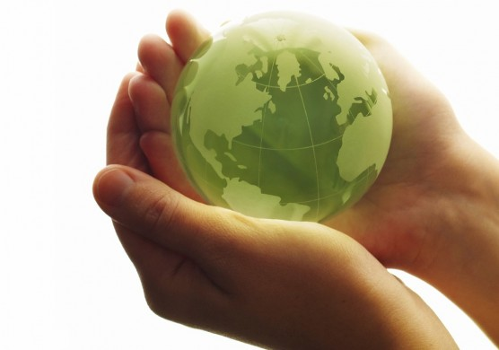 Woman holding green globe