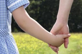 Woman holding little girl's hand