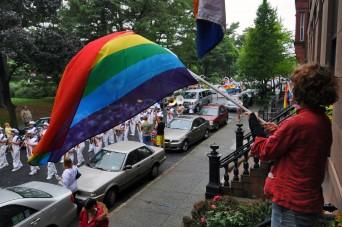 Woman waving LGBT flag