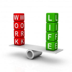 "The words ""work"" and ""life"" balancing on a see saw"