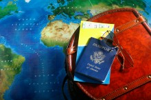 Map, passport and backpack for world travel
