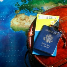 Map with passport and airline tickets
