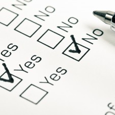 Close up of yes and no checkboxes with pen