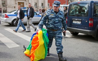 Russian solider with rainbow flag