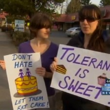 """Tolerance is sweet"" signs"