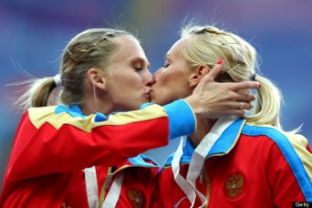 Gold medalist Tatyana Firova and Kseniya Ryzhova of Russia kiss in Moscow. (Photo: Paul Gilham/Getty Images)