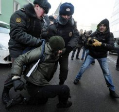 Russian activist detained by police.