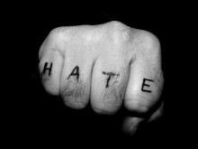 Hate tattoo on fingers