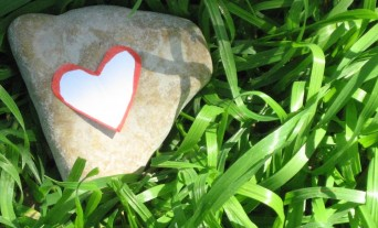 Heart-shaped rock in the grass