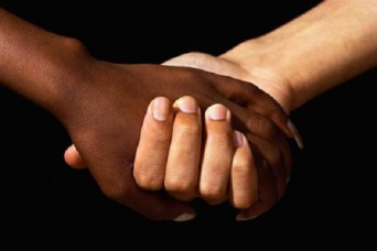 Interracial women holding hands